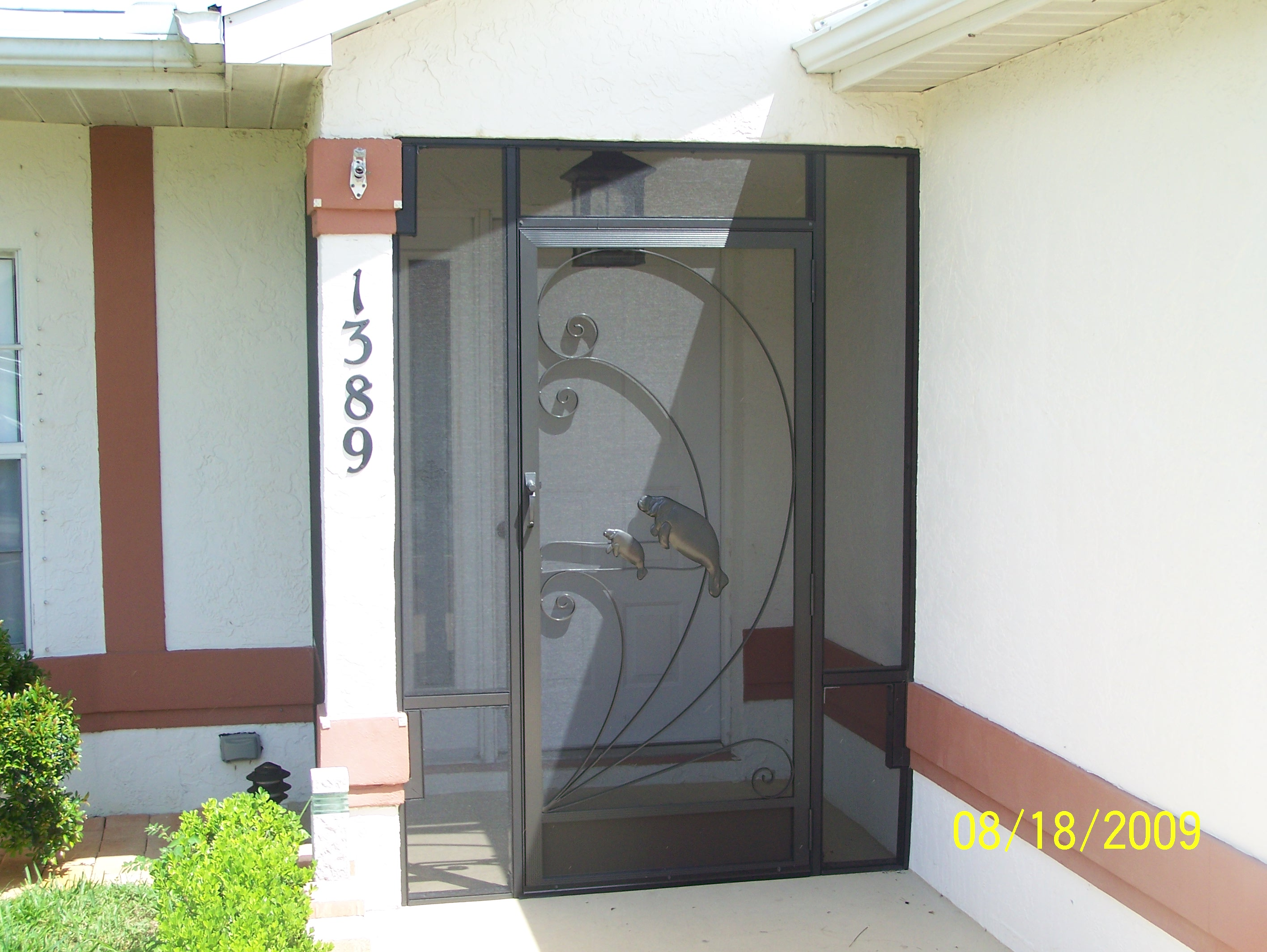 Screened Front Door with Manatee Decoration
