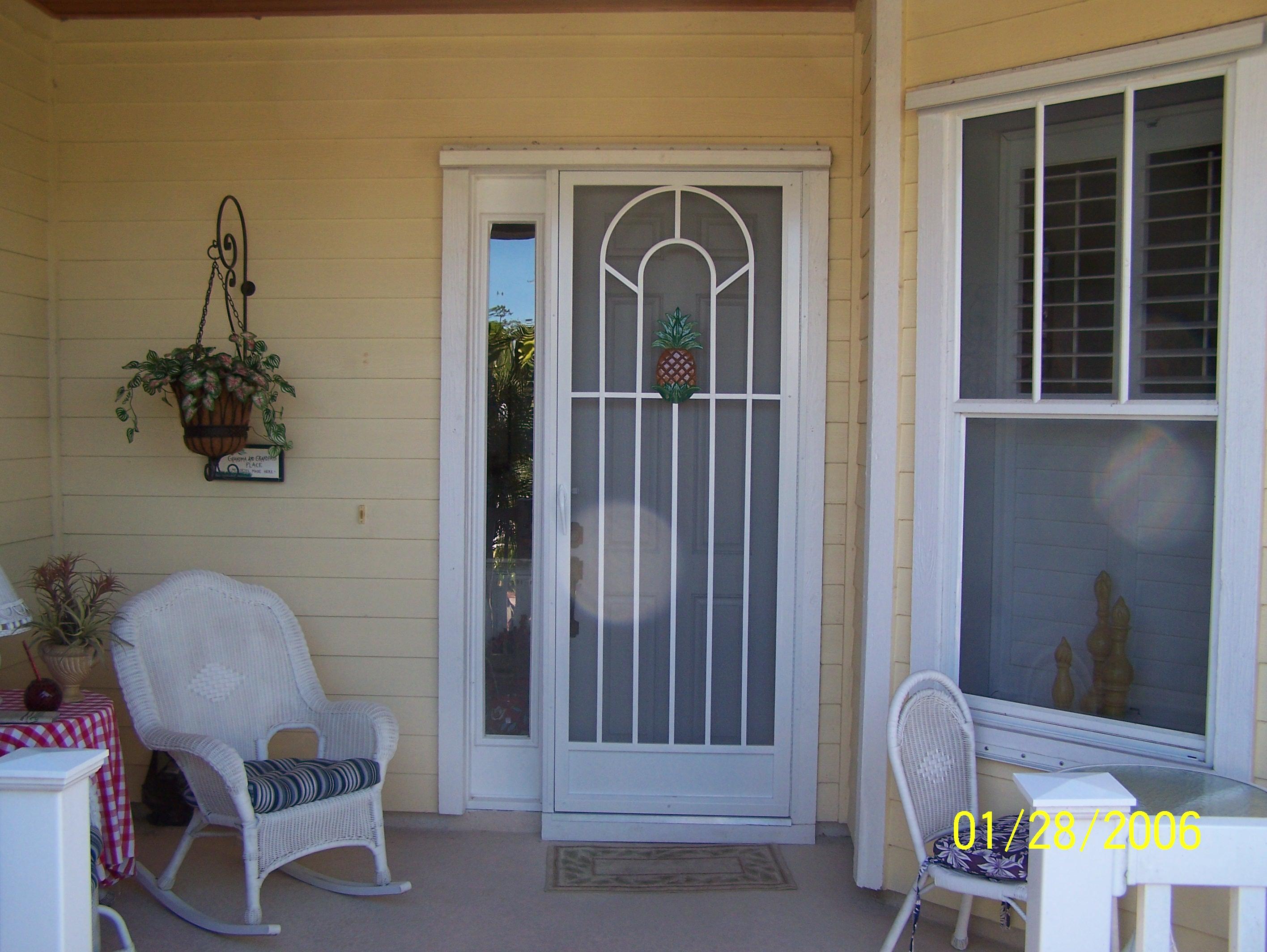Screened Door with Pineapple Decoration